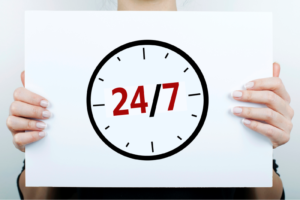 woman holding clock showing 24/7
